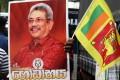 Sri Lanka Podujana Peramuna supporters hold a poster of presidential front runner Gotabhaya Rajapaksa. Photo: EPA