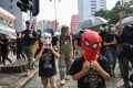 Young protesters wearing superhero masks join an anti-government rally in Jordan on October 20. A ban on face masks at public gatherings in Hong Kong took effect at midnight on October 4. on Photo: Winson Wong