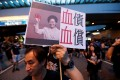 A protester holds a placard depicting Chief Executive Carrie Lam during a demonstration in Hong Kong on June 16. Photo: Reuters