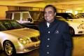 Mukesh Ambani with some of his cars in his garage – the first six floors of the Ambanis' Antilla home is dedicated to cars. Photo: YouTube