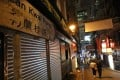 Unlike previous years, Hong kong party district Lan Kwai Fong was not heavily decorated for Halloween. Photo: Dickson Lee