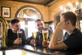 """Being around certain people could trigger the drinking """"learning"""" in the brain that encourages people to drink more. Photo: Alamy"""
