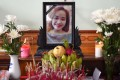 A portrait of Bui Thi Nhung, who is feared to be among the 39 people found dead in a truck in Britain, is kept on a prayer altar at her house in Vietnam's Nghe An province on Wednesday. Photo: AFP