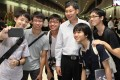 Lui Tuck Yew (fourth from left) with Singapore MRT commuters. Photo: Facebook