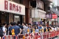 Crowds gather outside the Lung Mun Cafe in Hung Hom. Its owner supports the anti-government protesters. Photo: Dickson Lee