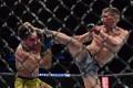 Stephen Thompson kicks Vicente Luque at UFC 244. Photo: AFP