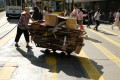 A woman pushes a trolley full of cardboard in Causeway Bay, in September 2018. Elderly people collecting cardboard for sale are a common sight on the streets of Hong Kong, where income inequality is high. Photo: Fung Chang