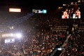 The UFC 244 welterweight bout between Jorge Masvidal and Nate Diaz is shown on screens at MGM Grand Garden Arena. Photo: AFP