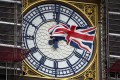 A Union flag waves against the backdrop of the clock facade of the Elizabeth Tower, which holds Big Ben. Photo: AP