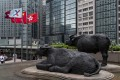 Bronze sculptures of bulls, the symbol of the Hong Kong stock exchange, at the Exchange Square in Central. Photo: Warton Li