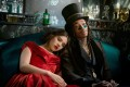 Hailee Steinfeld (who plays Emily Dickinson) and Wiz Khalifa (Death) in a still from Dickinson. Photo: Apple