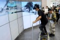 A visitor tries 5G intelligent skiing through VR at the China International Digital Economy Expo (CIDEE) in Shijiazhuang, north China's Hebei Province, Oct. 11, 2019. Photo: Xinhua