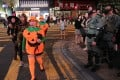 Police officers geared up for action in Lan Kwai Fong on October 31, as revellers dressed up for Halloween arrive in the entertainment district on Hong Kong Island. Photo: Sam Tsang