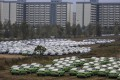 New cars are lined up at a BYD factory in Xian, Shaanxi province. China's economic output has slowed to the critical level of 6 per cent in the third quarter of the year. Photo: EPA-EFE