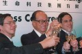 CK Hutchison's founder Li Ka-shing (centre) and CK Life Sciences' chairman Victor Li Tzar-kuoi (right) at the listing ceremony of the pharmaceutical and agriculture produce company's shares in Hong Kong on 3 July, 2002. Photo: SCMP