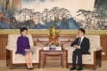 Chief Executive Carrie Lam (left) is received by Chinese Vice-Premier Han Zheng in Beijing. Photo: ISD