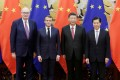 From left, EU trade commissioner-designate Phil Hogan, French President Emmanuel Macron, Chinese President Xi Jinping and Chinese Commerce Minister Zhong Shan mark a series of deals at the Great Hall of the People in Beijing. Photo: Reuters
