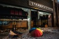 An umbrella and debris lie outside a vandalised Starbucks cafe in Sheung Wan district in Hong Kong. Photo: Bloomberg