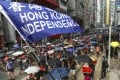 """A protester holds up a """"Hong Kong independence"""" flag during a march against the government's extradition bill from Causeway Bay to Admiralty on September 29. While not all protesters support Hong Kong independence, there is a widespread feeling that Hong Kong has a unique identity that is under threat and worth fighting for. Photo: Robert Ng"""