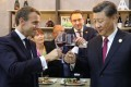 China's President Xi Jinping (right) and French President Emmanuel Macron (left) taste wine as they visit France's pavilion during the China International Import Expo in Shanghai. Photo: AFP