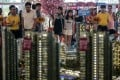 Foreign buyers view a scale model of a development in Johor, Malaysia. Photo: EPA
