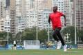Train like a champion marathon runner: Lukas Wambua Muteti demonstrating warm-up exercises in his training sessions in Hong Kong. Photo: May Tse