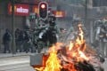 Riot police in action as the flames leap from a fire started by protesters in Wan Chai on November 2. Photo: Felix Wong