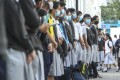 Students form a human chain in support of arrested schoolmates, outside a secondary school in Sha Tin on November 4. Photo: Winson Wong