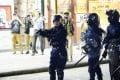 A police officer draws his gun in Yau Ma Tei. Photo: Editorial Board, CityU SU