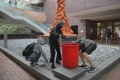 Students collect stones to be thrown at police near the Pillar of Shame, a sculpture at the University of Hong Kong, on November 12. Photo: AP