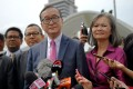 Sam Rainsy, centre, and Mu Sochua, in pink, field questions from reporters in Kuala Lumpur on November 12, 2019. Photo: SCMP/Tashny Sukumaran