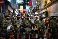 A line of police officers in Lan Kwai Fong, Hong Kong's entertainment district, during Halloween night on October 31. Photo: AFP