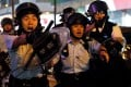 An online People's Daily commentary has demanded Hong Kong police be given more support to quell unrest and suggested an end to violence is necessary before the local elections in November. Photo: Reuters