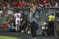 Hong Kong football team coach Mixu Paatelainen (centre) gestures during the Fifa World Cup 2022 qualifying match against Iran at Hong Kong Stadium in September. Photo: Felix Wong