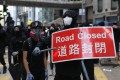 Protesters blocked roads, forcing the suspension of scores of bus routes in Hong Kong. Photo: EPA