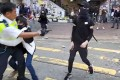 A video grab of the incident showing the moment before a protester approaching an officer is shot. Photo: AFP/ Cupid News