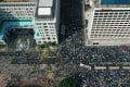 Aerial drone view of buses trapped amongst anti-government protesters in Tsim Sha Tsui, between The Peninsula hotel (left) and Sheraton Kowloon (right) on 20 October 2019. Photo: May Tse