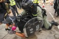 A police officer restrains a protester at Chinese University in Sha Tin on November 12. Photo: Winson Wong