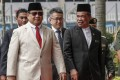 Indonesian counterpart Prabowo Subianto (left) with Malaysian defence minister Mohamad Sabu in Kuala Lumpur. Photo: EPA