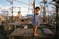 """Kowloon Walled City is depicted in stunning fashion by Greg Girard and Ian Lambot in photos including """"Children playing on Walled City rooftop (1989)"""", above, by Girard. Photo: courtesy of Blue Lotus Gallery"""