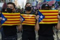 Demonstrators in Hong Kong hold Catalan pro-independence flags during a pro-democracy march, in Tsim Sha Tsui on October 20. Photo: AFP