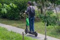 A food delivery man rides his electric scooter in Singapore. The city state has banned these devices from footpaths after a spate of accidents. Photo: AFP