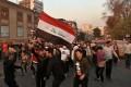 Protesters celebrate on the Ahrar Bridge, in Baghdad. Photo: AP Photo