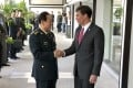 Chinese Defence Minister Wei Fenghe greets US counterpart Mark Esper in Bangkok on Monday. Photo: AP