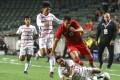 Hong Kong's Giovane Alves skips over a Cambodian defender during their World Cup qualifier at Hong Kong Stadium. Photo: May Tse