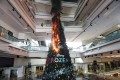 A Christmas tree burns after protesters set fire to it at Festival Walk shopping centre in Kowloon Tong, Hong Kong, on November 13, 2019. Photo: EPA-EFE