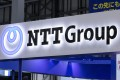 A logo of NTT Group is seen at a conference in Tokyo on April 3 this year. NTT said it was forming a global technology and services provider by combining capabilities of 28 of its companies, including NTT Communications Corp, Dimension Data Holdings and NTT Security Corp. Photo: Alamy
