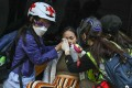 First aiders treat a woman affected by tear gas during anti-government protests in Central, Hong Kong. Photo: K.Y. Cheng