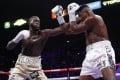 Deontay Wilder throws a left hand against Luis Ortiz in their heavyweight title match. Photo: AP