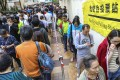 People queue up for the district council election at polling stations in Aberdeen Sports Centre. Photo: May Tse